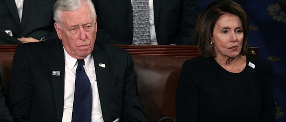 Rep Steny Hoyer (D-MD) and U.S. House Minority Leader Nancy Pelosi (D-CA) watch during the State of the Union address in the chamber of the U.S. House of Representatives January 30, 2018 in Washington, DC