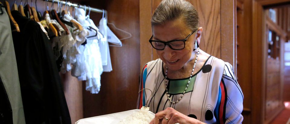 Justice Ruth Bader Ginsburg shows the many different collars (jabots) she wears with her robes, in her chambers at the Supreme Court. REUTERS/Jonathan Ernst