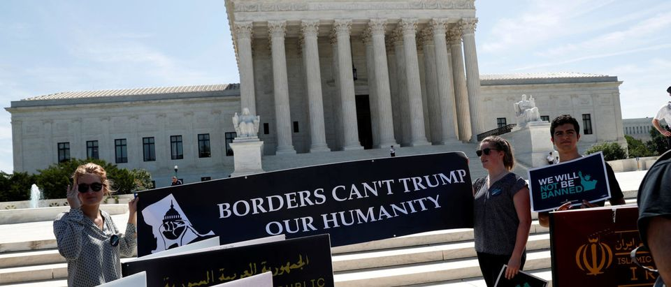 Immigration rights proponents demonstrate outside the U.S. Supreme Court in Washington