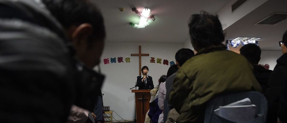 This photo taken on December 24, 2014 shows a pastor of an underground church conducting a Christmas Eve service at an apartment in Beijing. China is now home to an estimated 70 million Christians, according to a 2011 survey by the Pew Research Center, as people search for a sense of community and meaning in a fast-changing society. The vast majority of Chinese Protestants -- around 50 million, according to the survey -- shun state-run churches and worship in self-organising groups outside government-control.(GREG BAKER/AFP/Getty Images)