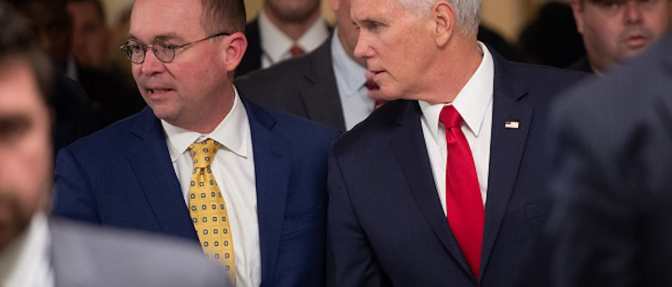 Vice President Mike Pence and Mick Mulvaney (L), Director of the Office of Management and Budget (OMB) and incoming White House Chief of Staff, walk between meetings to discuss a possible government shutdown, at the US Capitol in Washington, DC