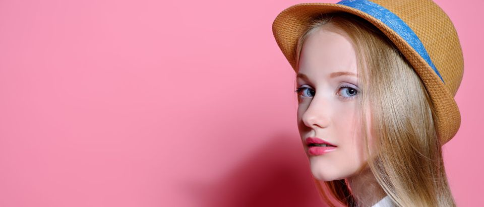 Pictured is a young girl with a hat. (Shutterstock/Kiselev Andrey Valerevich)