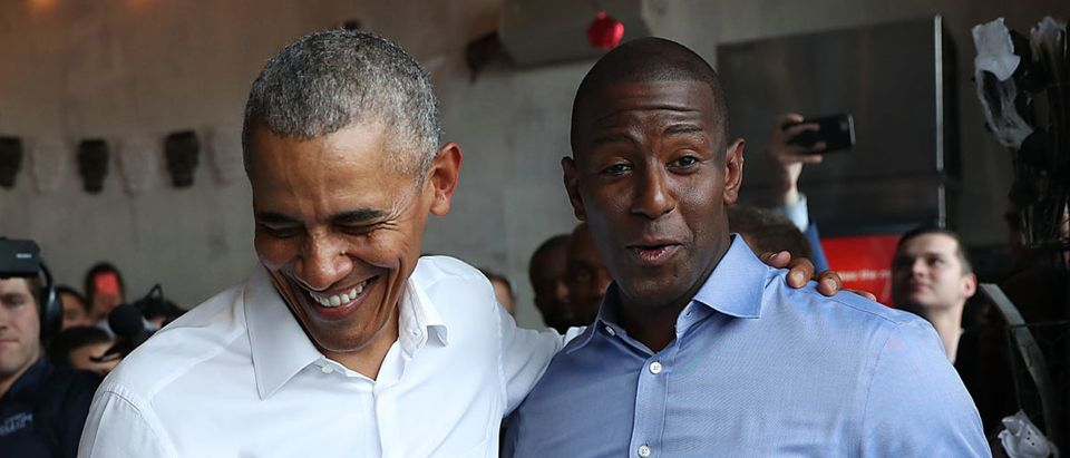Former President Barack Obama orders lunch with Florida Democratic gubernatorial candidate Andrew Gillum and U.S. Senator Bill Nelson at the Coyo Taco restaurant on Nov. 2, 2018 in Miami, Florida. (Joe Raedle/Getty Images)
