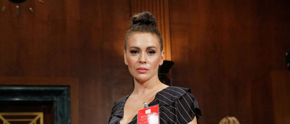 Actor Alyssa Milano stands in the hearing room after the conclusion of testimony before a Senate Judiciary Committee confirmation hearing for Kavanaugh by Professor Christine Blasey Ford, who has accused U.S. Supreme Court nominee Brett Kavanaugh of a sexual assault in 1982, on Capitol Hill in Washington, U.S., September 27, 2018. REUTERS/Jim Bourg
