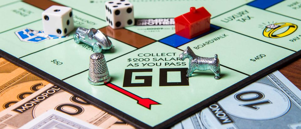 CALDWELL, IDAHO/USA - MARCH 16, 2015: Game pieces from game Monopoly sitting near the start