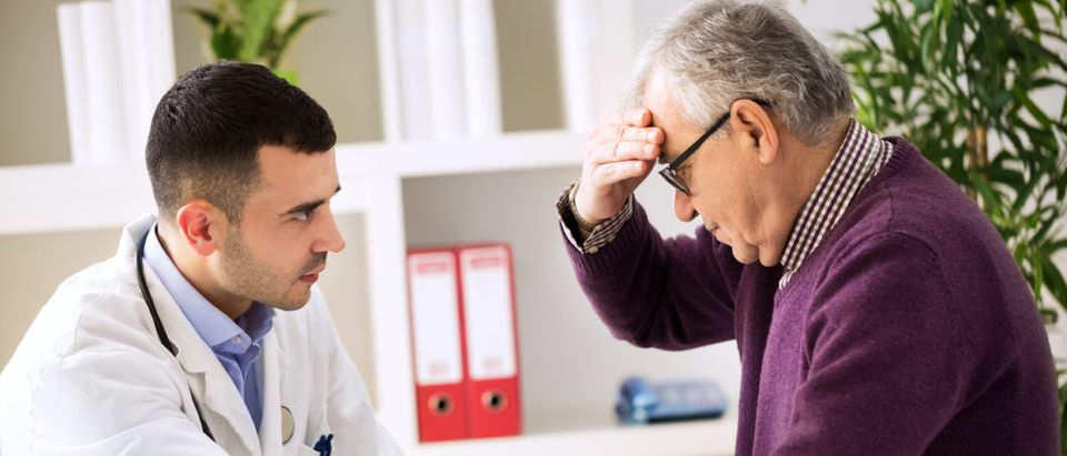 A doctor and patient consult. Shutterstock image via user didesign021