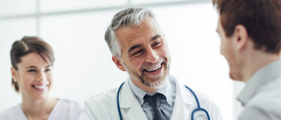 A doctor talks to a patient. Shutterstock image via user stokkete
