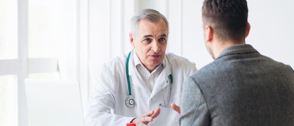 A doctor consults with a patient. Shutterstock image via user uzhursky