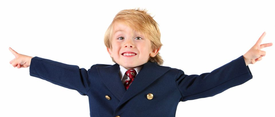 A kid politician poses for a photo. Shutterstock image via user Suzanne Tucker