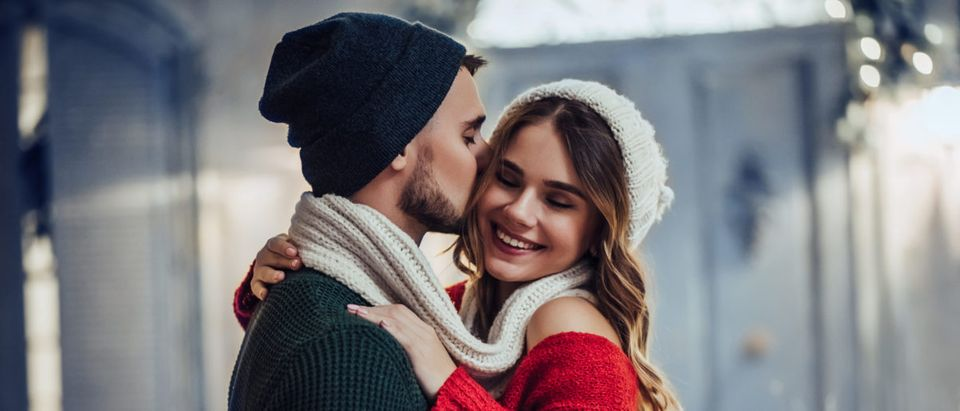 A couple enjoys the winter weather. Shutterstock image via user 4 PM production