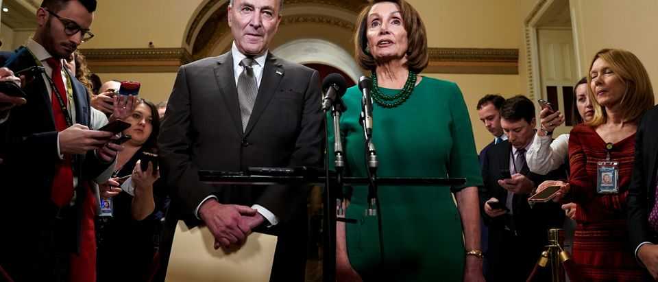 Senate Minority Leader Chuck Schumer (D-NY) and House Minority Leader Nancy Pelosi (D-CA) speak to the media ahead of a possible partial government shut down in Washington, U.S., December 20, 2018. REUTERS/Joshua Roberts