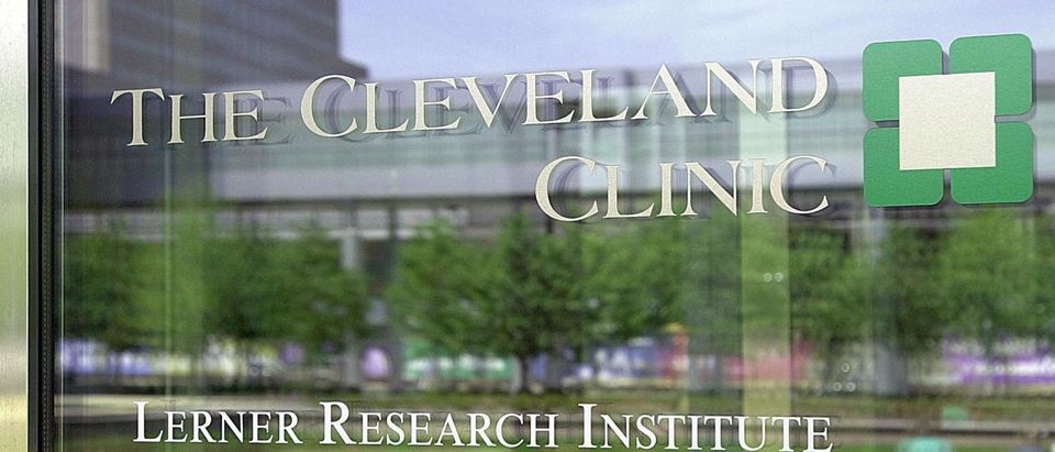 CLEVELAND, UNITED STATES: The Lerner Research Institute at the Cleveland Clinic is reflected in a doorway to the Clinic 10 May 2001 in Cleveland, OH. (DAVID MAXWELL/AFP/Getty Images)