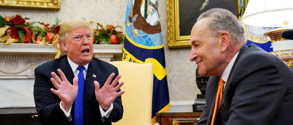 U.S. President Donald Trump talks with Senate Minority Leader Chuck Schumer (D-NY) as he meets with the Senate and House Democratic leadership at the White House in Washington, U.S., December 11, 2018. REUTERS/Kevin Lamarque