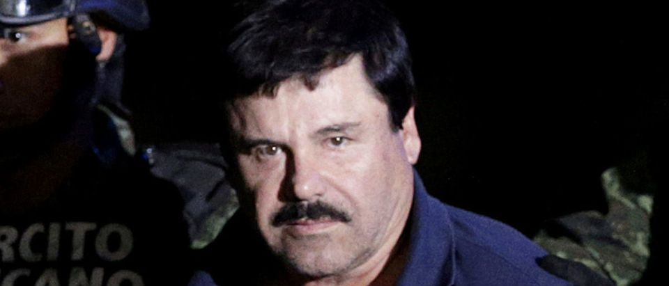 """FILE PHOTO: Recaptured drug lord Joaquin """"El Chapo"""" Guzman is escorted by soldiers at the hangar belonging to the office of the Attorney General in Mexico City, Mexico, January 8, 2016. REUTERS/Henry Romero"""