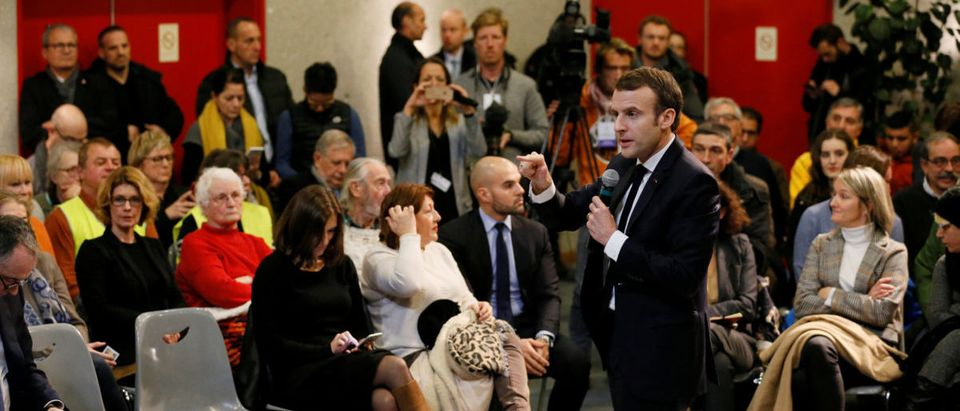 "French President Emmanuel Macron attends a meeting with local residents as part of the ""Great National Debate"" in Bourg-de-Peage near Valence, France, January 24, 2019. Macron visits the region as part of the ""Great National Debate"" designed to find ways to calm social unrest in the country. REUTERS/Emmanuel Foudrot"