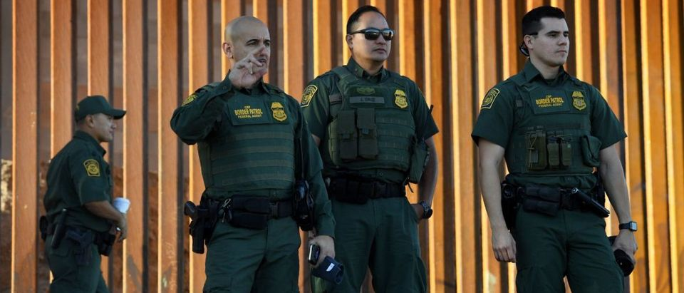 Border Patrol officers patrol before the US Secretary of Homeland Security inaugurates the first completed section of the 30-foot border wall in the El Centro Sector, at the US-Mexico border in Calexico, California on Oct. 26, 2018. (Photo by Mark RALSTON / AFP)