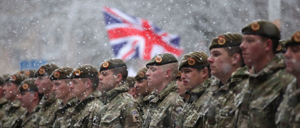 Soldiers of The 1st Battalion Duke of Lancaster's Regiment brave the snow as they march through the streets of Blackburn following a six-month tour of duty in Afghanistan on December 1, 2010 in Blackburn, England. (Photo by Christopher Furlong/Getty Images)