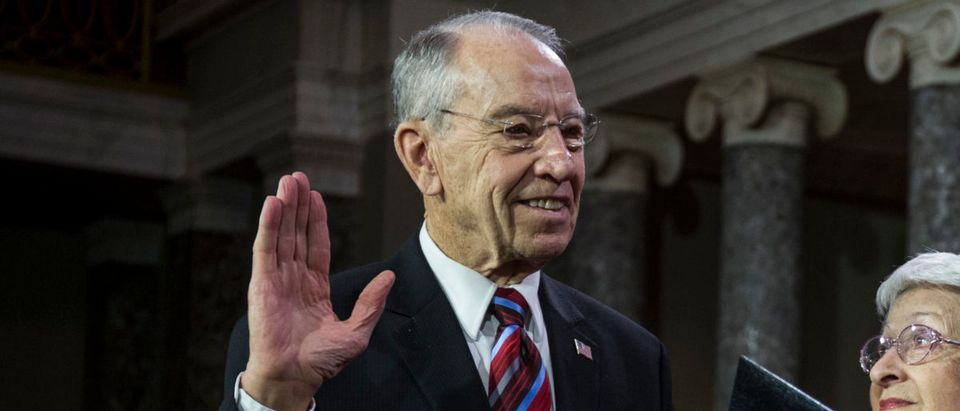Sen. Chuck Grassley (R-IA) participates in a mock swearing in ceremony with Vice President Mike Pence on Capitol Hill on January 3, 2019 in Washington, DC. (Photo by Zach Gibson/Getty Images)
