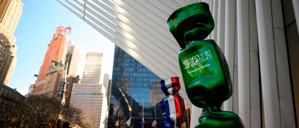 A sculpture with the flag of Saudi Arabia, part of an exhibit called 'Candy Nations' is pictured outside next to the Oculus, one of the buildings that replaced the original World Trade Center on January 14, 2019 in New York City. - Candy Nations depicting the flags of each of the G20 countries as 9-foot-tall wrapped confections, has drawn criticism for its placement outside 1 World Trade Center. (Photo by Johannes EISELE / AFP) / RESTRICTED TO EDITORIAL USE - MANDATORY MENTION OF THE ARTIST UPON PUBLICATION - TO ILLUSTRATE THE EVENT AS SPECIFIED IN THE CAPTION (Photo credit should read JOHANNES EISELE/AFP/Getty Images)
