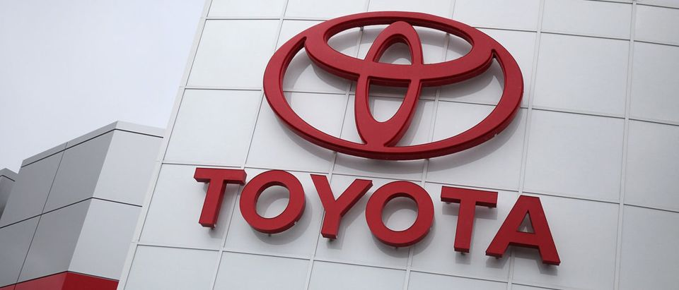 The Toyota logo is displayed on the exterior of a Toyota dealership on February 24, 2011 in Oakland, California. (Photo by Justin Sullivan/Getty Images)