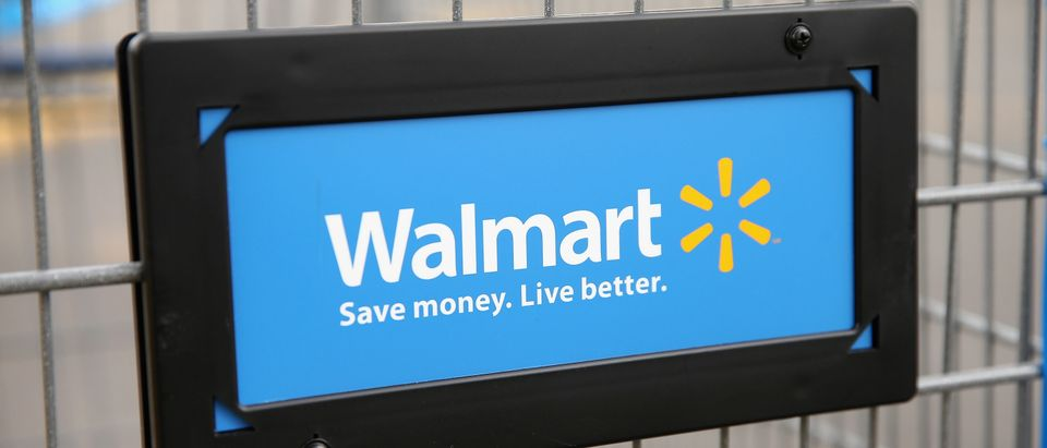 The Walmart logo is displayed on a shopping cart at a Walmart store on August 15, 2013 in Chicago, Illinois. (Photo by Scott Olson/Getty Images)