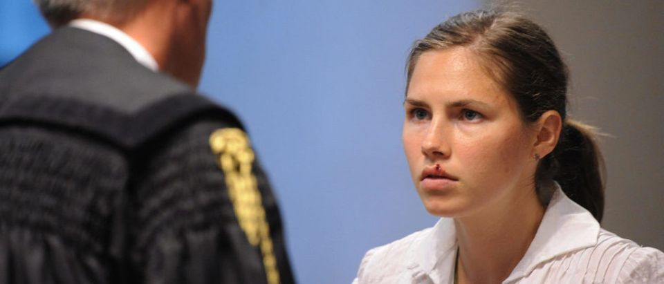 US Amanda Knox, accused of killing her British housemate two-years ago, listens to questions during her trial on June 12, 2009 in the courtroom in Perugia. Knox was testifying during this court session for the first time in her sex-murder trial, with the American accused of taking part in the 2007 killing of her British housemate Meredith Kercher in Italy. AFP PHOTO / TIZIANA FABI