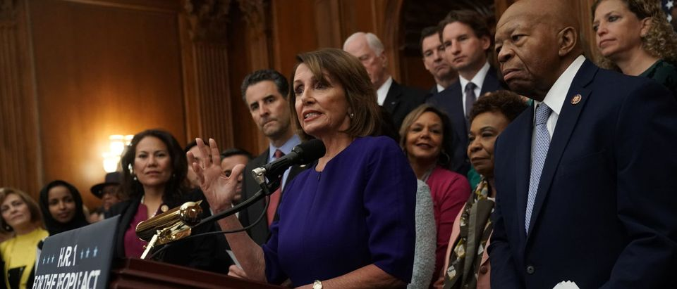 "WASHINGTON, DC - JANUARY 04: Flanked by other House Democrats, U.S. Speaker of the House Rep. Nancy Pelosi (D-CA) speaks during a news conference at the U.S. Capitol January 4, 2019 in Washington, DC. Speaker Pelosi held a news conference to introduce H.R.1, the ""For the People Act,"" a reform package ""to restore the promise of our nation's democracy, end the culture of corruption in Washington, and reduce the role of money in politics to return the power back to the American people."" (Photo by Alex Wong/Getty Images)"