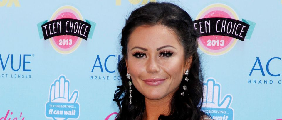 "Television personality Jenni ""JWoww"" Farley poses as she arrives at the Teen Choice Awards at the Gibson amphitheatre in Universal City, California August 11, 2013. REUTERS/Fred Prouser"