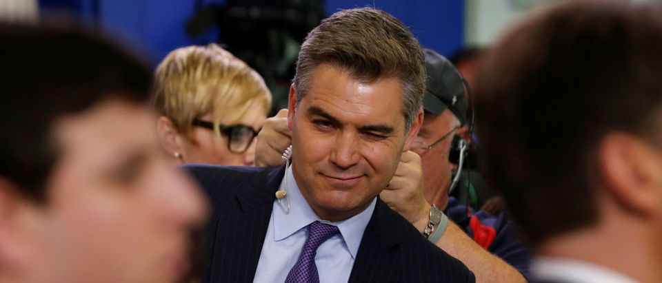 CNN White House correspondent Jim Acosta winks at a fellow reporter after the daily press briefing, during which he had a contentious exchange with White House senior policy advisor Stephen Miller, at the White House in Washington, U.S. Aug. 2, 2017. REUTERS/Jonathan Ernst