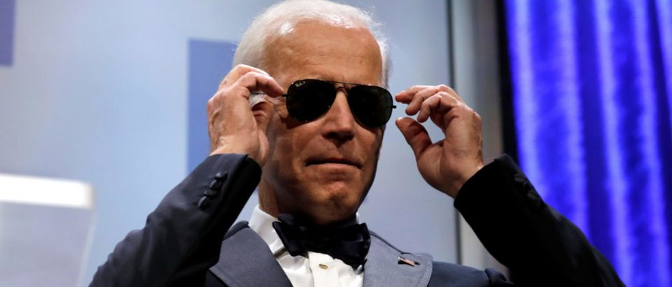 Former U.S. Vice President Joe Biden wears sunglasses at the Human Rights Campaign (HRC) dinner in Washington, U.S., Sept. 15, 2018. REUTERS/Yuri Gripas