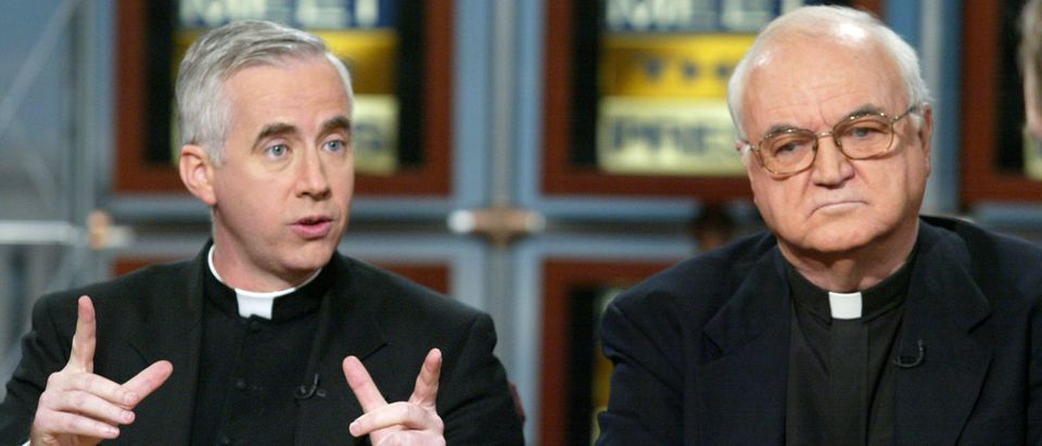 Father John McCloskey (L) of the Catholic Information Center, and Father Richard McBrien (R) of the University of Notre Dame talk about the recent sex scandals of Catholic Church on NBC's ''Meet the Press'' March 31, 2002 in Washington, DC. (Photo by Alex Wong/Getty Images)