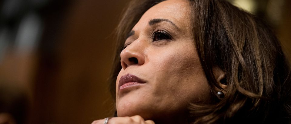 FILE PHOTO: Sen. Kamala Harris listens to Christine Blasey Ford's testimony during the Senate Judiciary Committee hearing on on Capitol Hill in Washington
