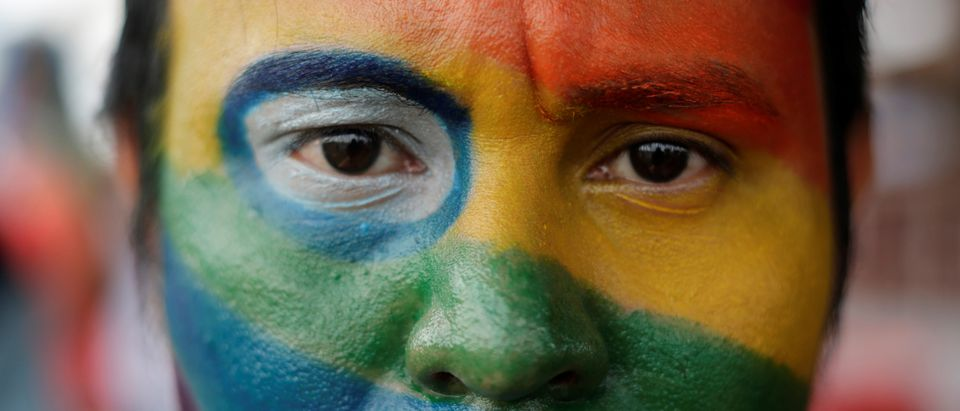 An activist with his face painted in the colours of the rainbow flag participates in a march organized by the LGBT community in Managua, Nicaragua, June 28, 2018. REUTERS/Jorge Cabrera -