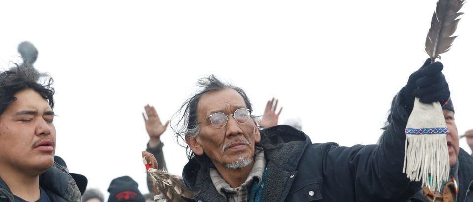 Nathan Phillips prays with other protesters near the main opposition camp against the Dakota Access oil pipeline near Cannon Ball, North Dakota, U.S., Feb/ 22, 2017. REUTERS/Terray Sylvester