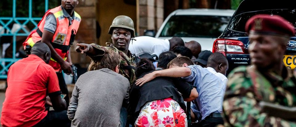 Special forces protect people at the scene of an explosion at a hotel complex in Nairobi's Westlands suburb on January 15, 2019, in Kenya. - A huge blast followed by a gun battle rocked an upmarket hotel and office complex in Nairobi on January 15, 2018, causing casualties, in an attack claimed by the Al-Qaeda-linked Shabaab Islamist group. (LUIS TATO/AFP/Getty Images)