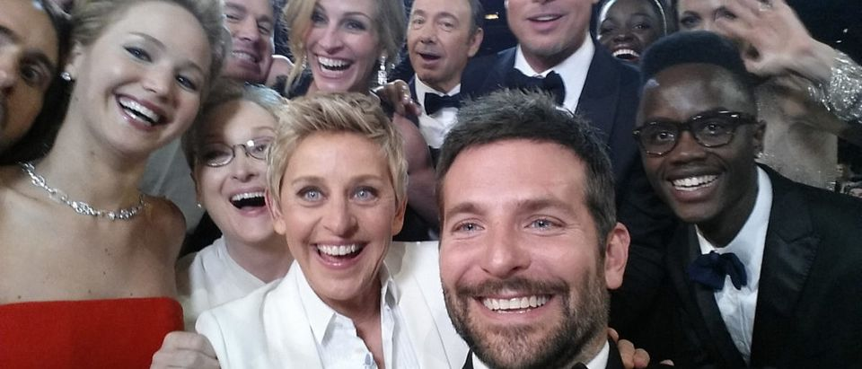HOLLYWOOD, CA - MARCH 02: In this handout photo provided by Ellen DeGeneres, host Ellen DeGeneres poses for a selfie taken by Bradley Cooper with (clockwise from L-R) Jared Leto, Jennifer Lawrence, Channing Tatum, Meryl Streep, Julia Roberts, Kevin Spacey, Brad Pitt, Lupita Nyong'o, Angelina Jolie, Peter Nyong'o Jr. and Bradley Cooper during the 86th Annual Academy Awards at the Dolby Theatre on March 2, 2014 in Hollywood, California. (Photo credit Ellen DeGeneres/Twitter via Getty Images)