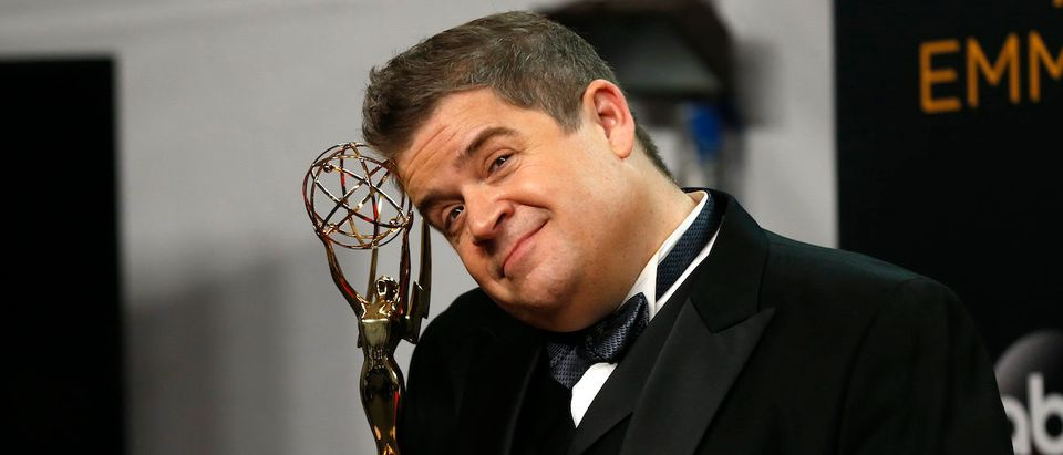 "Writer Patton Oswalt poses backstage with his award for Outstanding Writing For A Variety Special for ""Patton Oswalt: Talking For Clapping"" at the 68th Primetime Emmy Awards in Los Angeles, California U.S., September 18, 2016. REUTERS/Mike Blake"