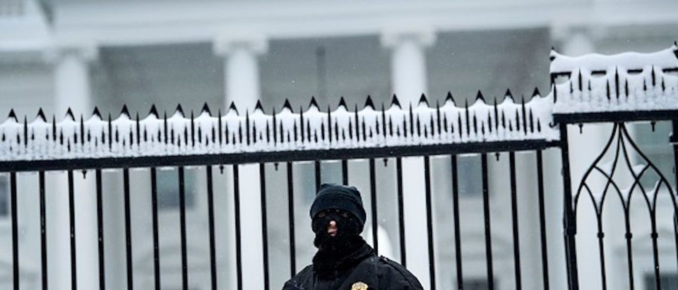 A member of the Secret Service stands guard outside the White House during the 23rd day of the US government shutdown January 13, 2019 in Washington, DC. - Washington area residents woke up to a winter wonderland, and may need to shovel aside several inches of snow that fell overnight as a winter storm warning remains in effect until 6 p.m. Sunday and more snow is expected to fall. (Photo: BRENDAN SMIALOWSKI/AFP/Getty Images)