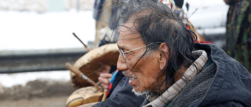 Nathan Phillips marches with other protesters out of the main opposition camp against the Dakota Access oil pipeline near Cannon Ball