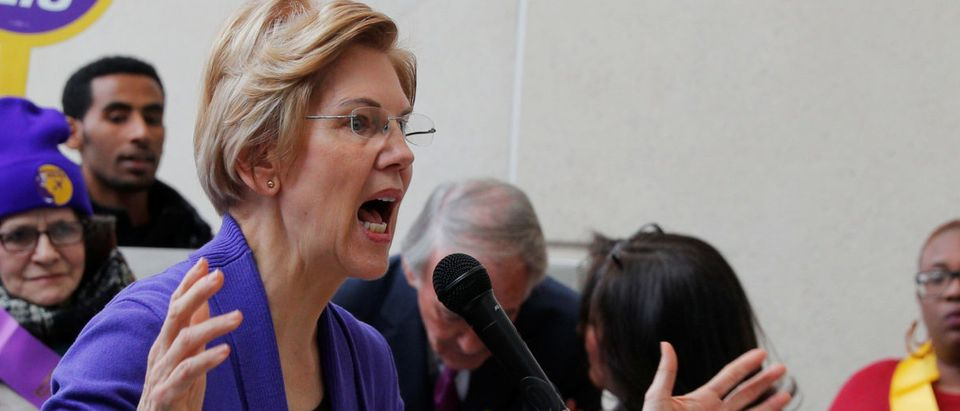 Potential 2020 Democratic presidential candidate Warren speaks about federal government employees working without pay at Logan Airport in Boston