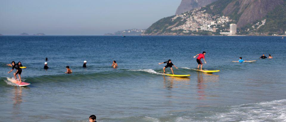 Children play on Arpoador beach in Rio de Janeiro