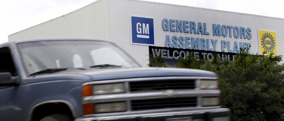 Chevrolet pickup truck drives past the General Motors Assembly Plant in Arlington, Texas
