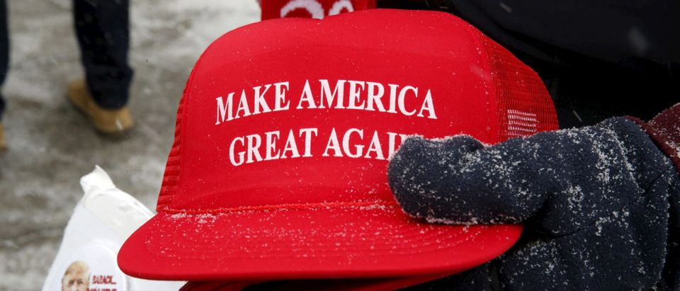 "A woman who attacked a man sporting a ""Make America Great Again"" hat was apprehended Tuesday by Immigration and Customs Enforcement after authorities discovered she is unlawfully present in the U.S. (Photo: Jim Bourg/ Reuters)"