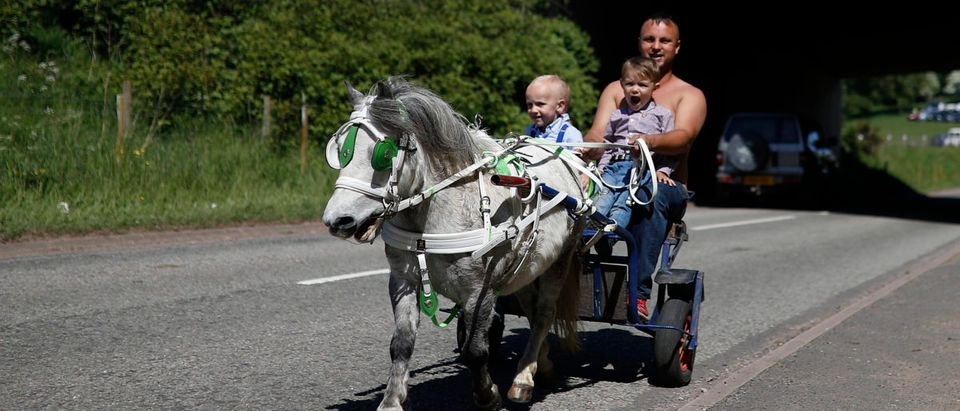 Members of the traveller community ride a horse drawn buggy during the horse fair in Appleby-in-Westmorland, northern Britain, June 2, 2016. REUTERS/Phil Noble