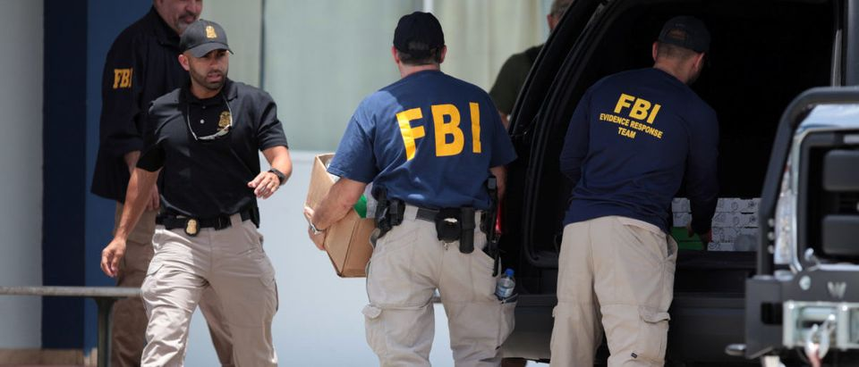 FBI personnel load boxes into a car during a raid, in July 19, 2017. REUTERS/Alvin Baez