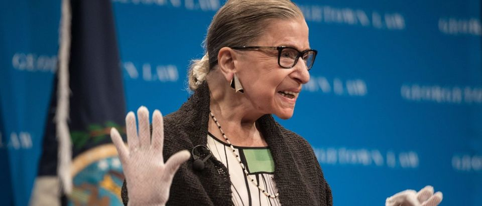 Justice Ruth Bader Ginsburg acknowledges applause as she arrives to speak to Georgetown University law students on September 20, 2017. (Nicholas Kamm/AFP/Getty Images)