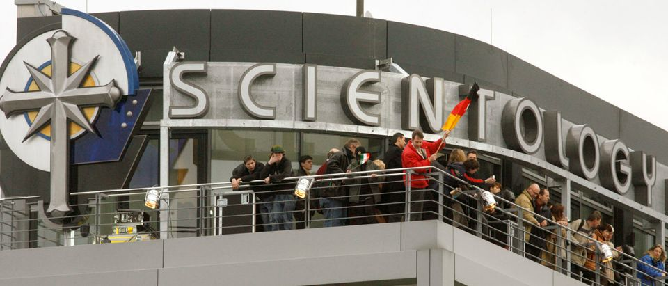 People stand on a balcony of the new office of the Scientology Church in Berlin January 13, 2007. REUTERS/Arnd Wiegmann