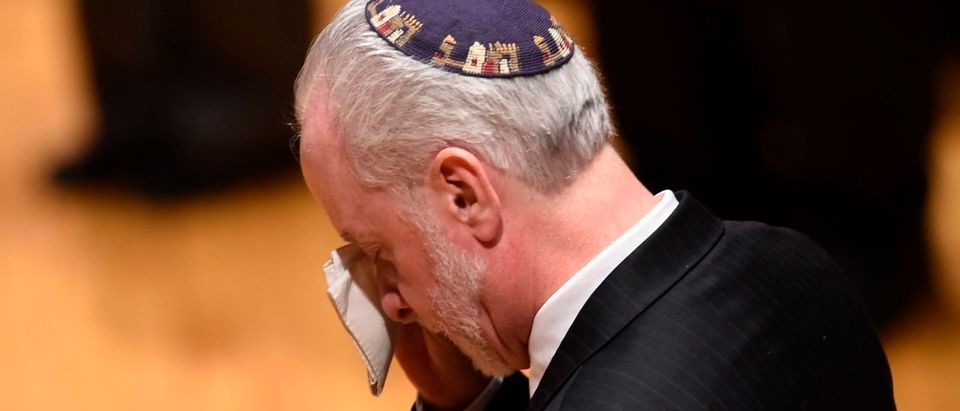 Rabbi Hazzan Jeffrey Myers, from the Tree of Life synagogue, cries during a vigil, to remember the victims of the shooting at his synagogue the day before, at the Allegheny County Soldiers Memorial on October 28, 2018, in Pittsburgh, Pennsylvania. (BRENDAN SMIALOWSKI/AFP/Getty Images)