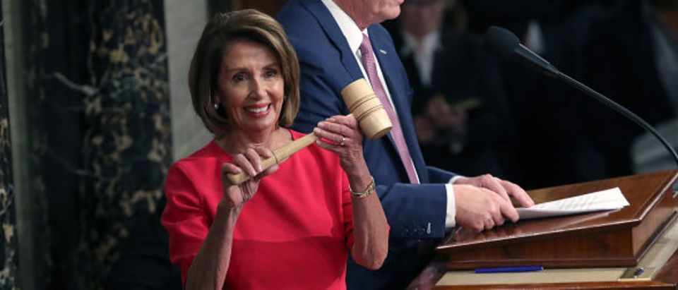 Speaker of the House Nancy Pelosi (D-CA) receives the gavel from Rep. Kevin McCarthy -- Win McNamee Getty Images