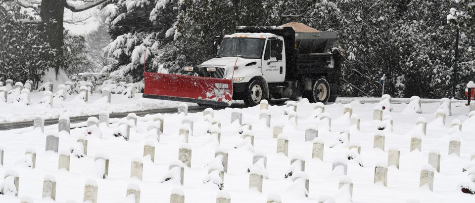 A snow plow prepares to clear roads of snow left by Winter Storm Gia, which paralyzed much of the nation's midsection, at Arlington National Cemetery, Arlington, Virginia, U.S., January 13, 2019. REUTERS/Mike Theiler